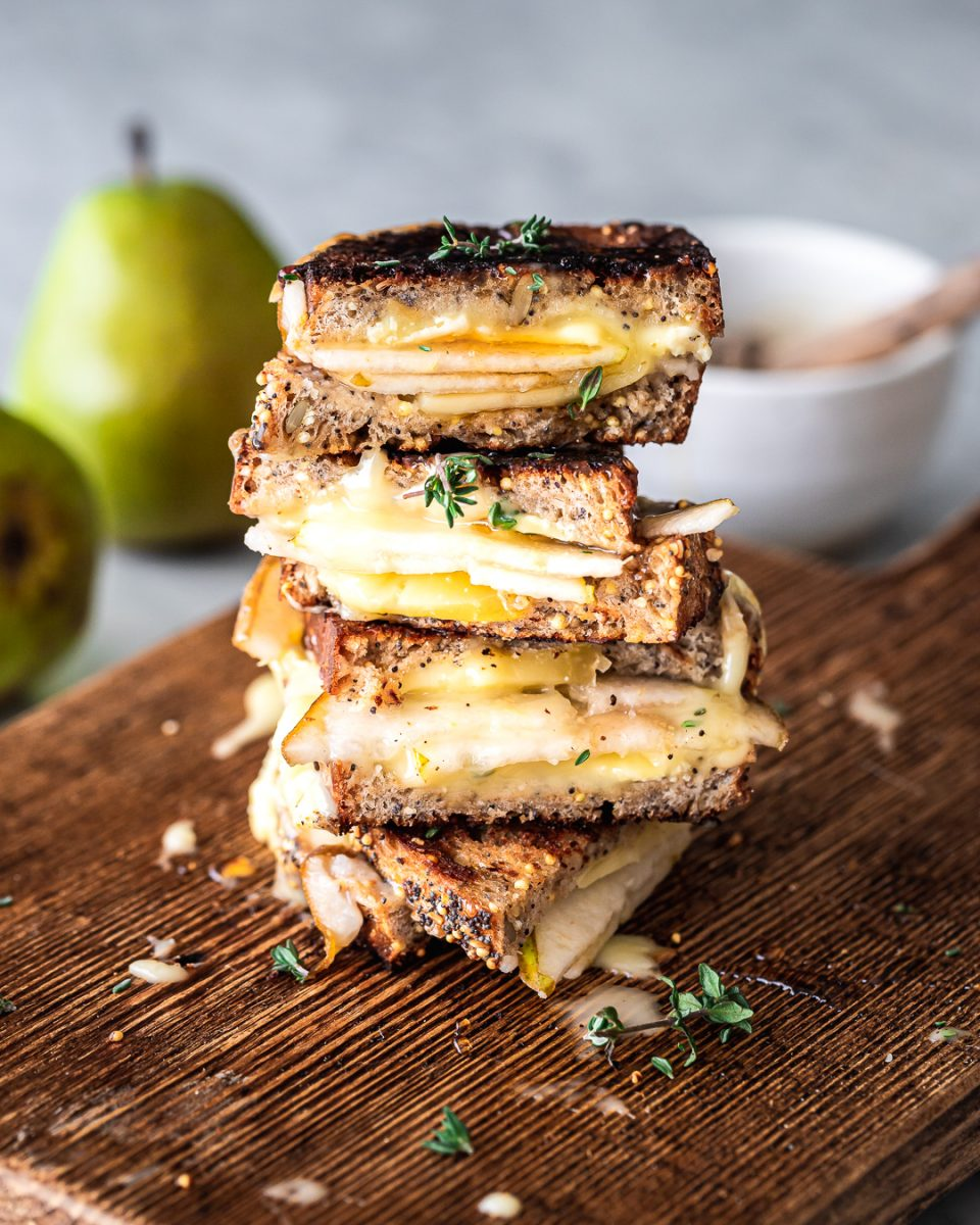 Stacked slices of Brie and Pear Grilled Cheese Sandwich