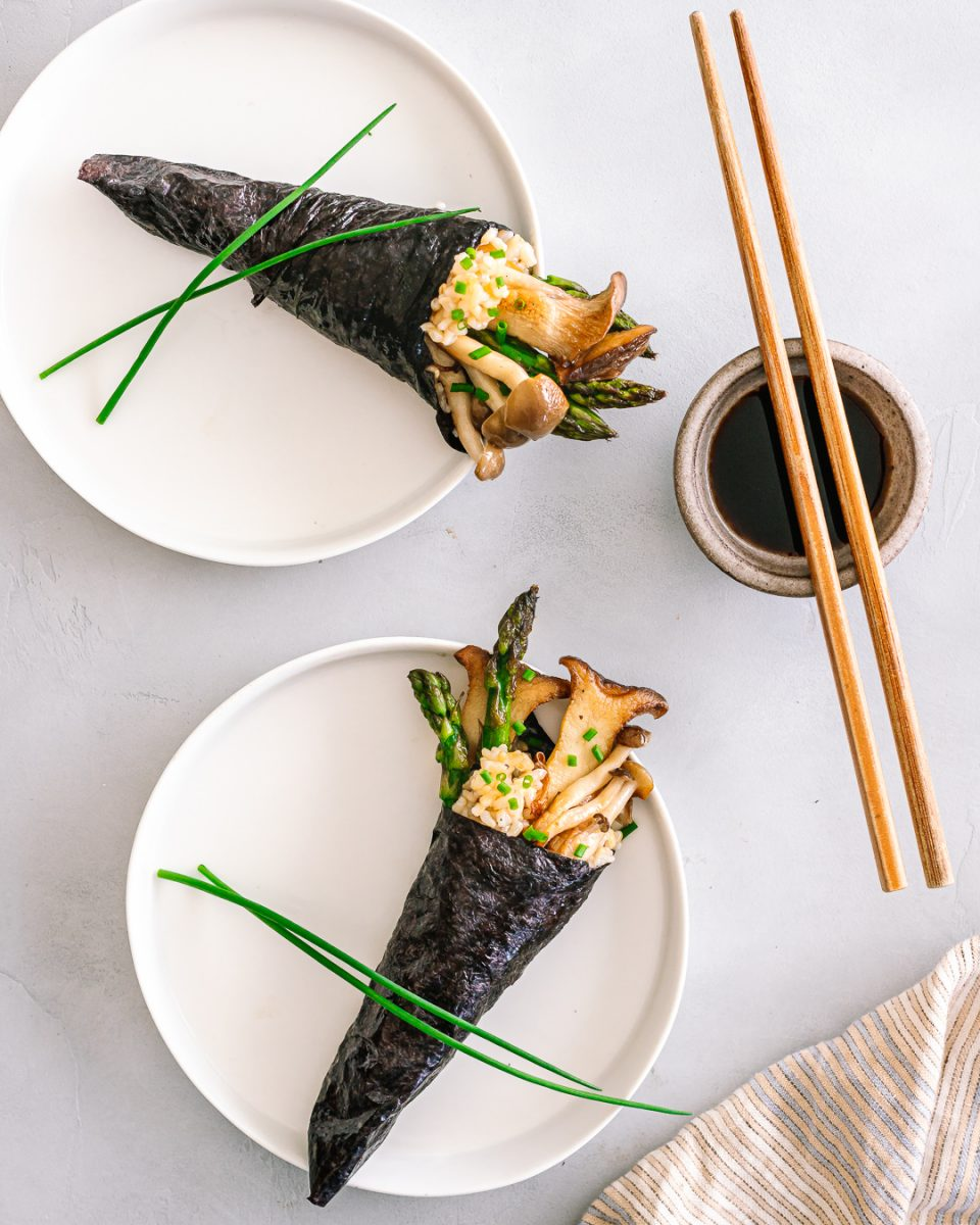 Vegetable Sushi Hand Rolls with soy sauce and chopsticks