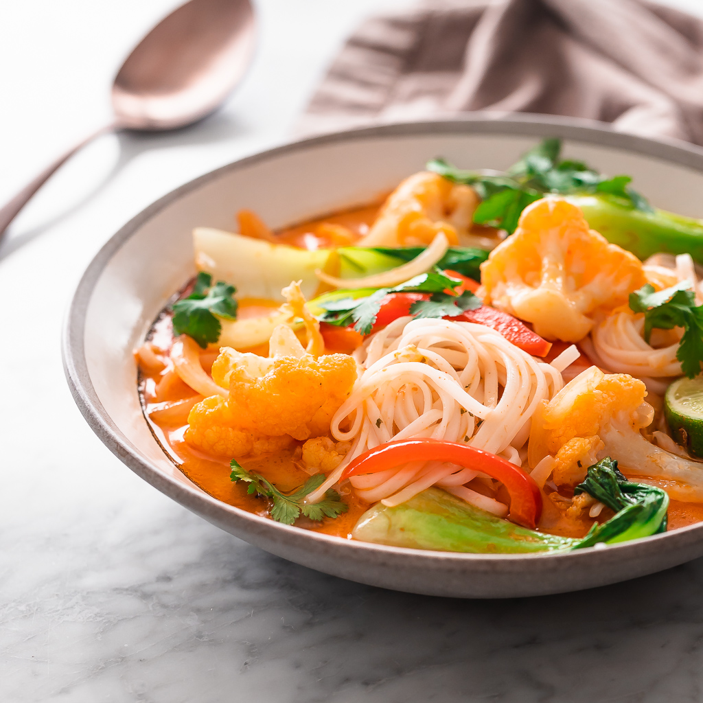 Coconut Red Curry Soup with rice noodles, cauliflower, red bell pepper and bok choy