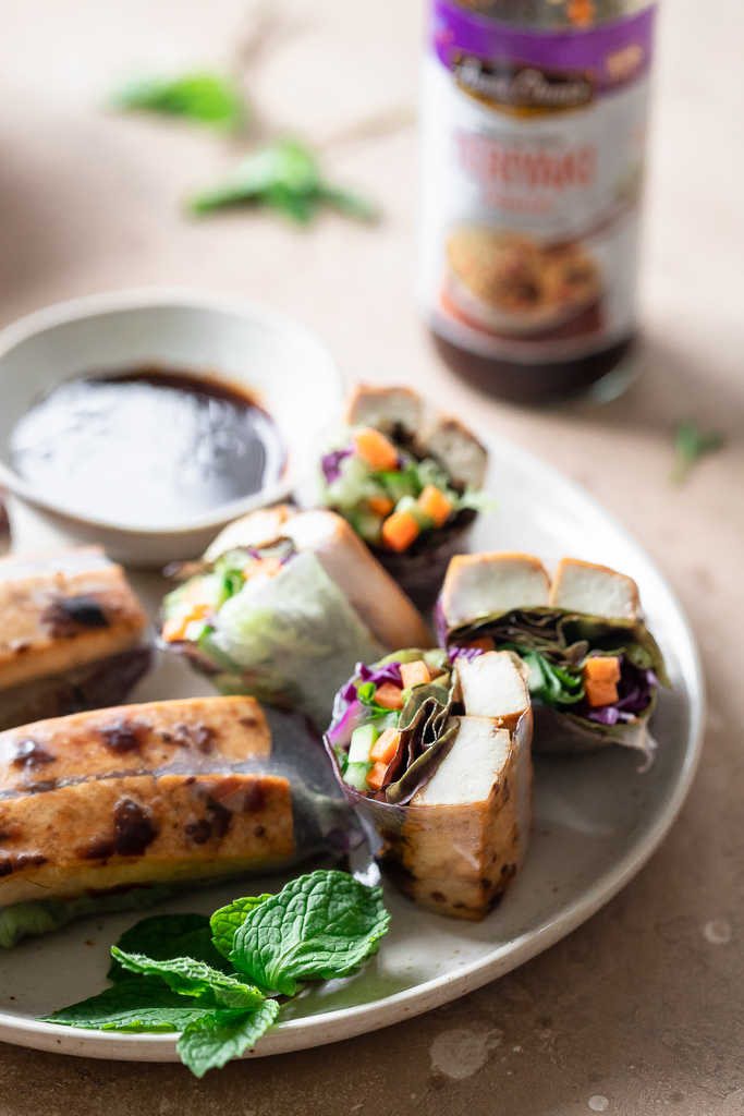 tofu spring rolls on a plate with fresh mint
