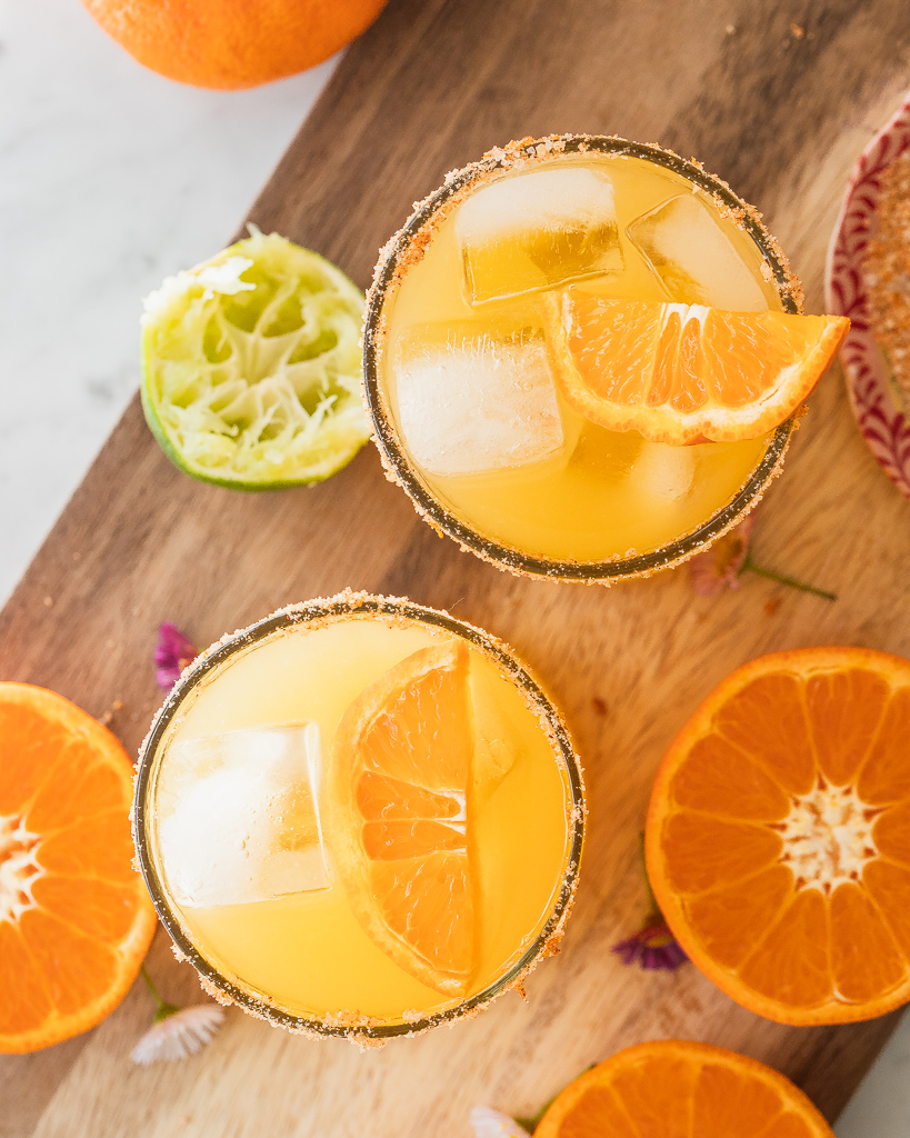 overhead view of two clementine margaritas with a salt rim