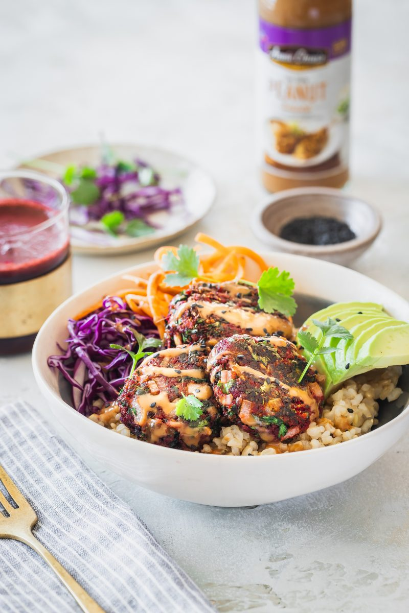 Buddha bowl with juice pulp fritters and peanut sauce
