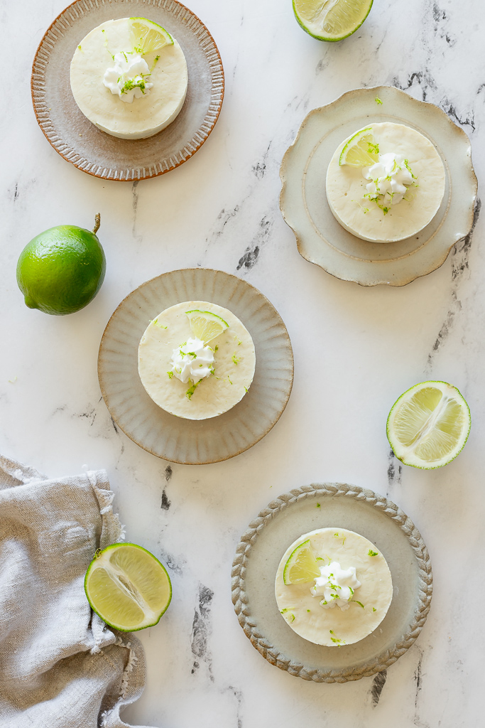 Individual vegan margarita cheesecakes on ceramic plates