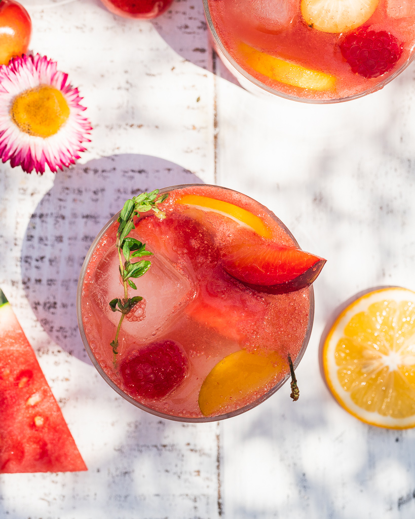 watermelon rosé sangria in a glass with plums and berries
