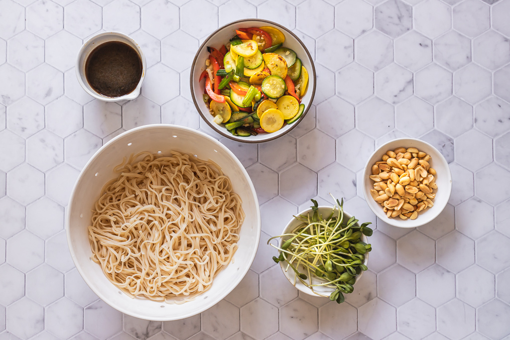 vegan pad Thai sauce, sauteed vegetables, cooked brown rice noodles, peanuts and sprouts