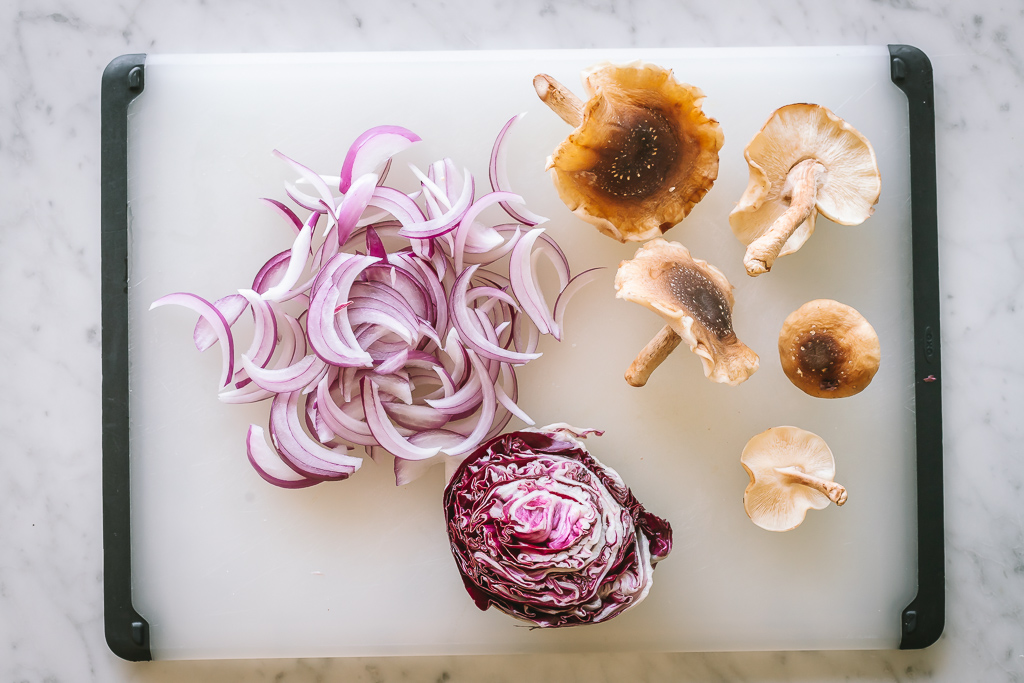 red cabbage and fresh shiitake mushrooms on a chopping board
