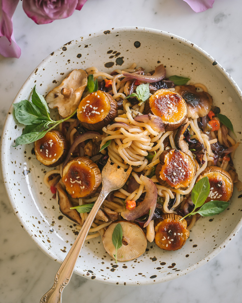 a fork twirling egg noodles in an Asian Miso Glazed Eggplant Noodle Bowls made with Annie Chun's yakisoba noodles