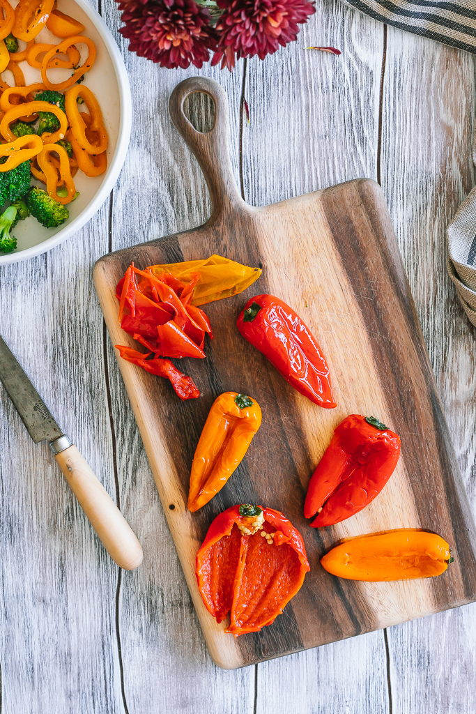roasted sweet mini peppers on a wooden cutting board