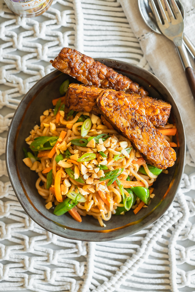 vegan thai peanut noodles served in a gray bowl with soy glazed tempeh