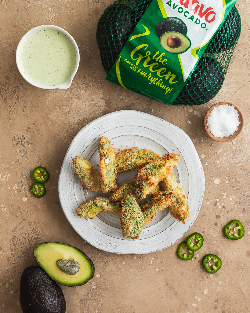 baked avocado fries with jalapeño ranch on a white plate