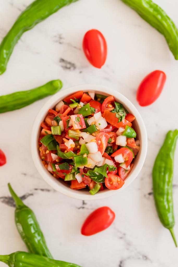a small bowl with homemade shishito pepper salsa