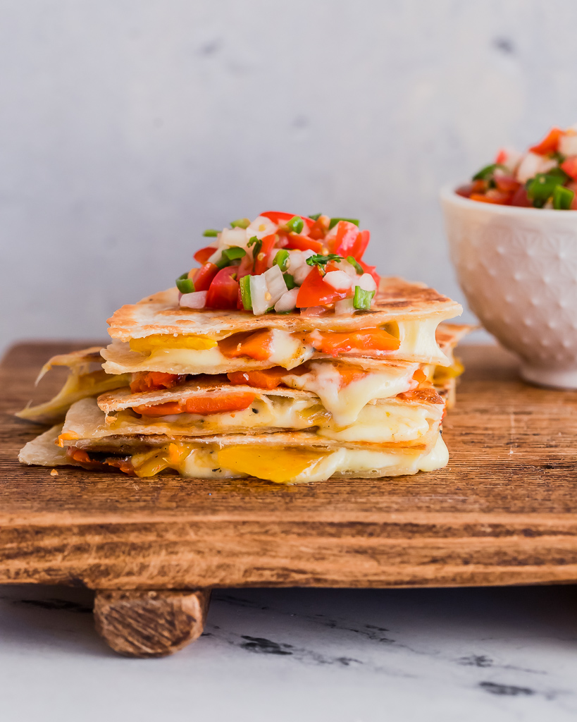 a stack of homemade vegetarian quesadillas with roasted red bell peppers and cheese