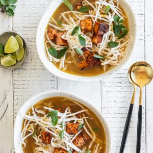 bowls of pho with rice noodles and baked tofu