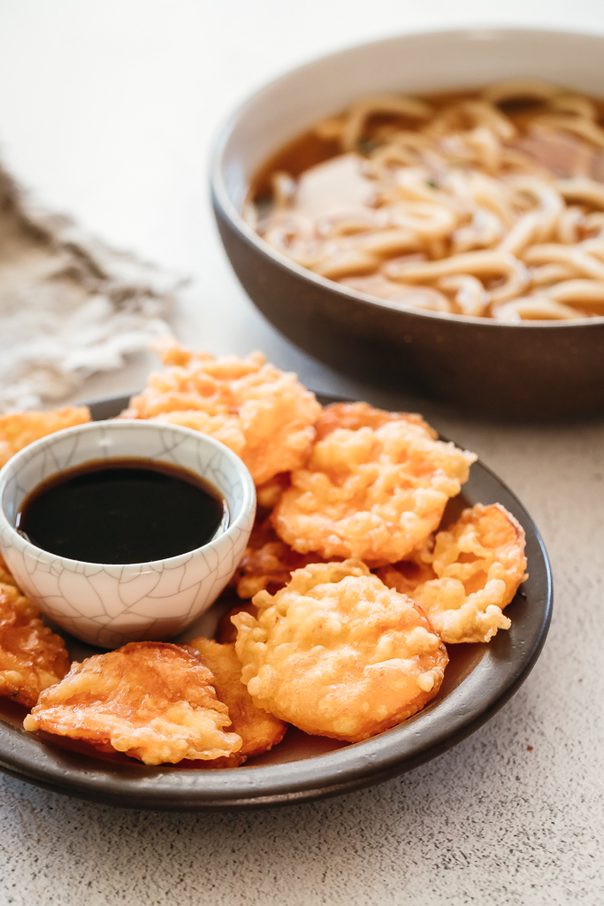 sweet potato tempura on a plate with soy dipping sauce