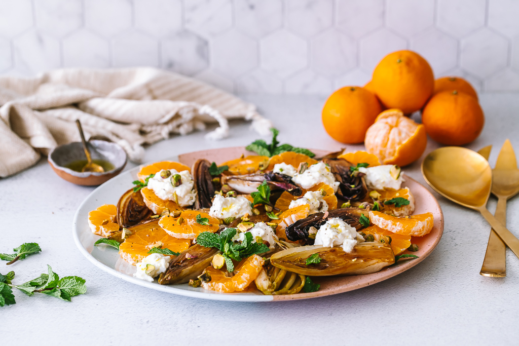 caramelized endive salad with clementines and chunks of burrata cheese