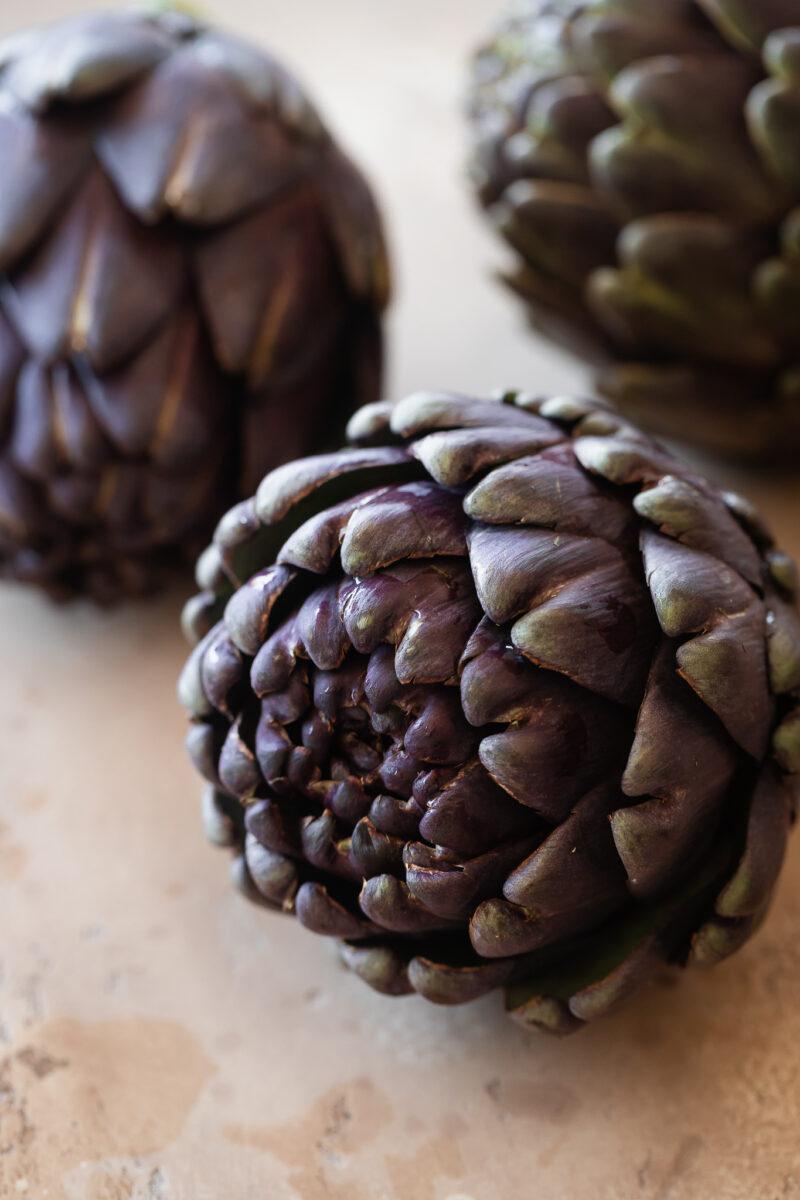 Close up shot of a purple artichoke.